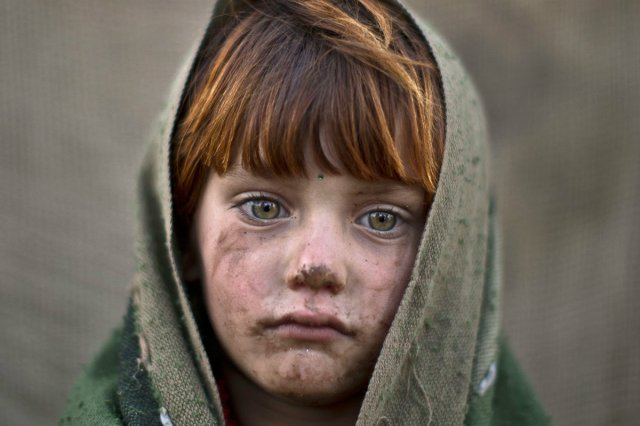 Laiba Hazrat, 6, poses for a picture. Islamabad, Pakistan